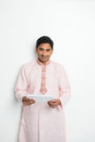 Traditional indian male with tablet Stock Images