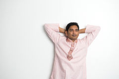 Traditional indian male thinking. With plain background and copyspace on right stock photo