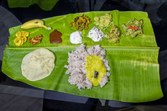 Traditional Indian meal on banana leaf. Traditional Indian meal from Kerala served on banana leaf Stock Image