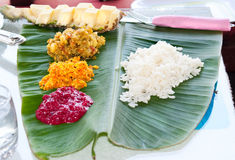 Traditional Indian meal serve on banana leaves Stock Images