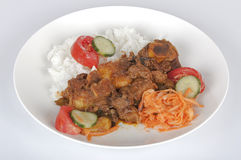 Traditional Indian Mutton Curry with Rice and Salads Stock Photography