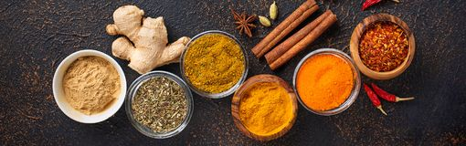 Traditional Indian spices on rusty background Royalty Free Stock Photo