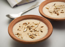 Traditional Indian Sweet. A traditional punjabi dessert made of rice and milk with almonds set on earthen plate Stock Photography