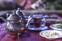 Traditional indian tea served in Teapot. Traditional indian mint tea served in Teapot in oriental background Royalty Free Stock Photo