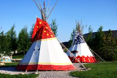 Tipis, traditional indian tents. Traditional indian tipis, in front of Buffalo Bill Museum in Cody, Wyoming, USA stock photography