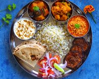 Traditional Indian Thali or Indian Gujarati meal. Indian meal or Thaali consisting of different curries like sev tomato na shak,aloo gobhi-cauliflower curry,aloo Stock Image