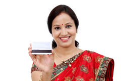 Traditional Indian woman holding a credit card Royalty Free Stock Images