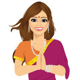 Traditional Indian woman holding hands in prayer position Royalty Free Stock Photos