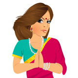 Traditional Indian woman holding hands in prayer position Stock Photo