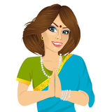 Traditional Indian woman holding hands in prayer position Royalty Free Stock Photography