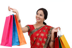 Traditional Indian woman holding shopping bags Stock Photography