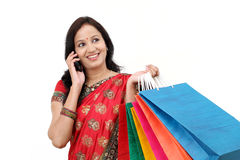 Traditional Indian woman holding shopping bags Stock Image