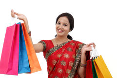 Traditional Indian woman holding shopping bags Stock Images