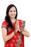 Traditional Indian woman in prayer position. Traditional Indian woman holding hands in prayer position Stock Images
