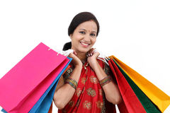 Traditional Indian woman with shopping bags Stock Images