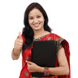 Traditional Indian woman showing thumbs up Royalty Free Stock Images