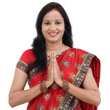 Traditional Indian woman woman greeting Namaste. Against white background royalty free stock image