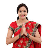 Traditional Indian woman woman greeting Namaste. Against white background Royalty Free Stock Photography