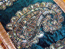 Traditional indian work on saree. Close of a patch of design of sequence work on saree Stock Images