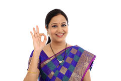 Traditional Indian Young woman making OK sign Royalty Free Stock Images