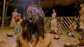 Traditional Indigenous Ceremony In The Jungle By Night. With Kids Around The Fire In Ecuador stock footage