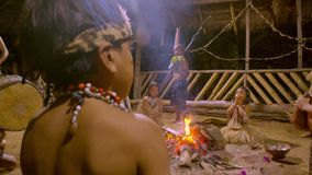 Traditional indigenous ceremony in the jungle by night. With kids playing drums in Ecuador stock footage