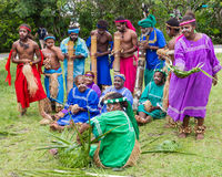 Traditional indigenous choir in New Caledonia. Lifou Island, New Caledonia - Apr 6, 2011: Traditional choir entertaining tourists in Vanuatu at Lifou Island, New Royalty Free Stock Photos