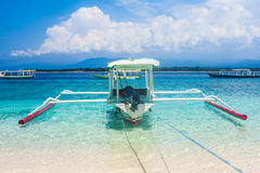 Traditional Indonesia boat Jukung. On a tropical beah royalty free stock photography