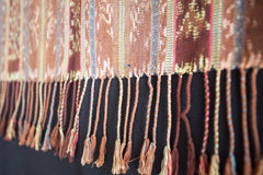 Traditional Indonesian and Asian pattern on fabric with tassels royalty free stock image