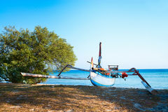 Traditional indonesian boat on the beach Stock Photos
