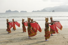 Traditional Indonesian dancers in Merah Beach,Banyuwangi Royalty Free Stock Photo