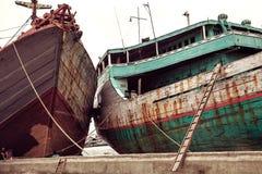 Traditional Indonesian phinisi boat docking at Sunda Kelapa old royalty free stock images