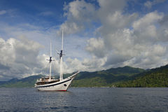 Traditional Indonesian Phinisi Schooner. These boats are made by hand and are designed to ply the waters of the Indonesian archipelago royalty free stock image