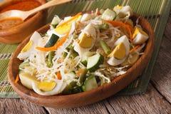 Traditional Indonesian salad gado-gado close-up. horizontal Stock Image