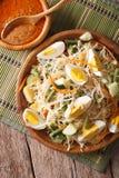Traditional Indonesian salad gado-gado closeup. vertical top vie Royalty Free Stock Photo