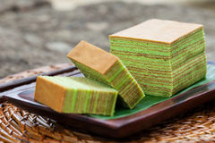 Traditional Indonesian sweet Lapis layer cake on a wooden background. Stock Photography