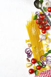 Traditional ingredients of italian cuisine : pasta,cheese and as. Sortment of vegetables on a white slate,stone or concrete background.Top view with copy space Royalty Free Stock Image
