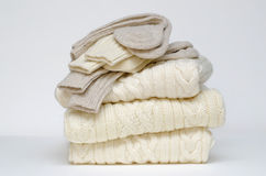 Traditional Irish Aran woolen knits. Stack of winter socks and sweaters in traditional Irish cable knit patterns Royalty Free Stock Photography