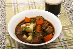 Traditional irish beef and guinness stew with carrot and fresh p. Traditional irish beef and guinness beer stew with carrots and fresh parsley in a plate Stock Photo