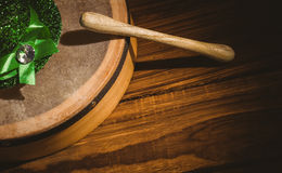 Traditional Irish bodhran and stick. On wooden table Stock Photography
