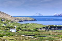 Traditional Irish House overlooking Skellig Michael. Traditional house overlooking Ballinskelligs Bay and Skellig Michael, one of the locations of the new Star Stock Images
