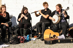 Traditional irish music and dance. Group of irish musicians and dancers playing traditional tunes in a farmer's market. Bray . Ireland Stock Image