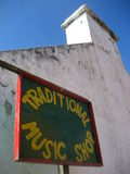 Traditional Irish music shop. A view of the side and sign outside a music shop that sells traditional Irish music stock images
