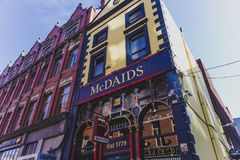 Traditional Irish pubs along the streets of Dublin city centre. DUBLIN, IRELAND - April 14th, 2018: traditional Irish pubs along the streets of Dublin city Royalty Free Stock Images