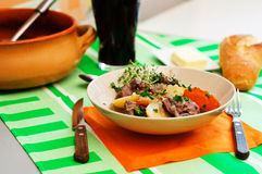 Traditional Irish stew. Served with fresh bread, butter and Guinness beer Stock Photo