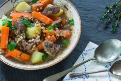 Traditional Irish stew - high angle view. Traditional Irish stew with lamb, potatoes, carrot and barley - high angle view Royalty Free Stock Images