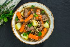 Traditional Irish stew - top view. Traditional Irish stew with lamb, potatoes, carrot and barley - top view Stock Photo