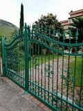 A traditional iron gate of a house entrance stock image