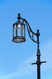 Traditional iron streetlight. Royalty Free Stock Photos