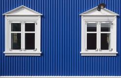 Traditional islandic metallic facade. Siglufjordur. Iceland. Traditional islandic metallic blue facade with two windows royalty free stock photography